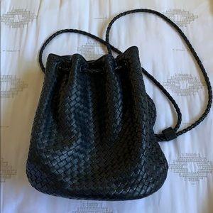 black leather woven drawstring bucket bag backpack